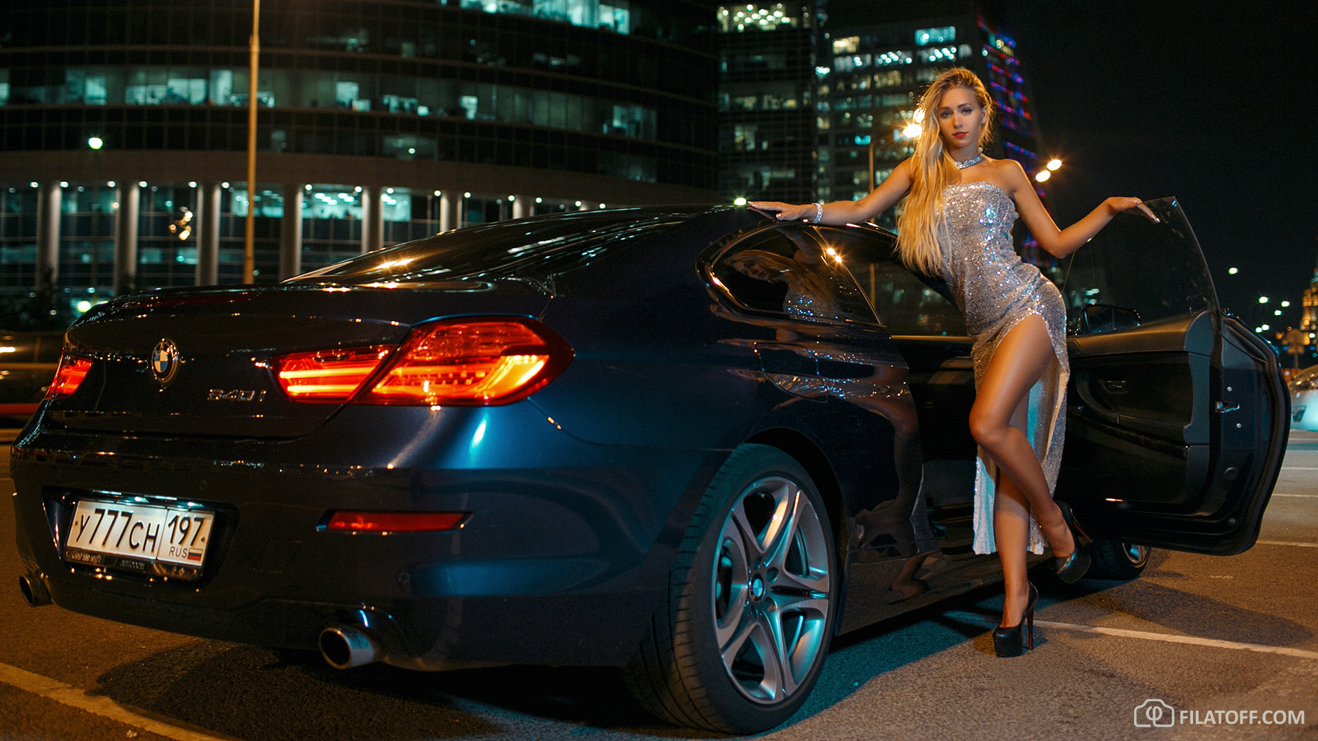 Blonde stunner in cocktail dress and BMW 640i