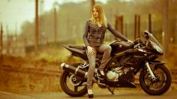 Blonde model and bike